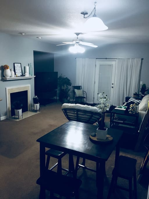 Livingroom with fireplace & patio access