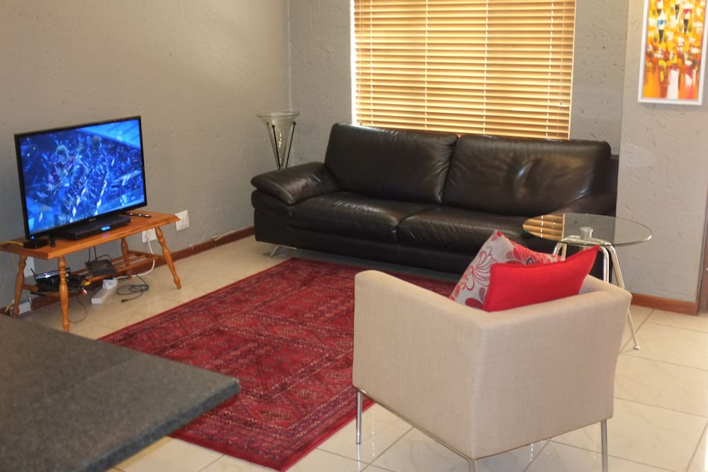 Luxury leather 3 seater, Kirman rug, LED TV with USB support and HDMI dvd player