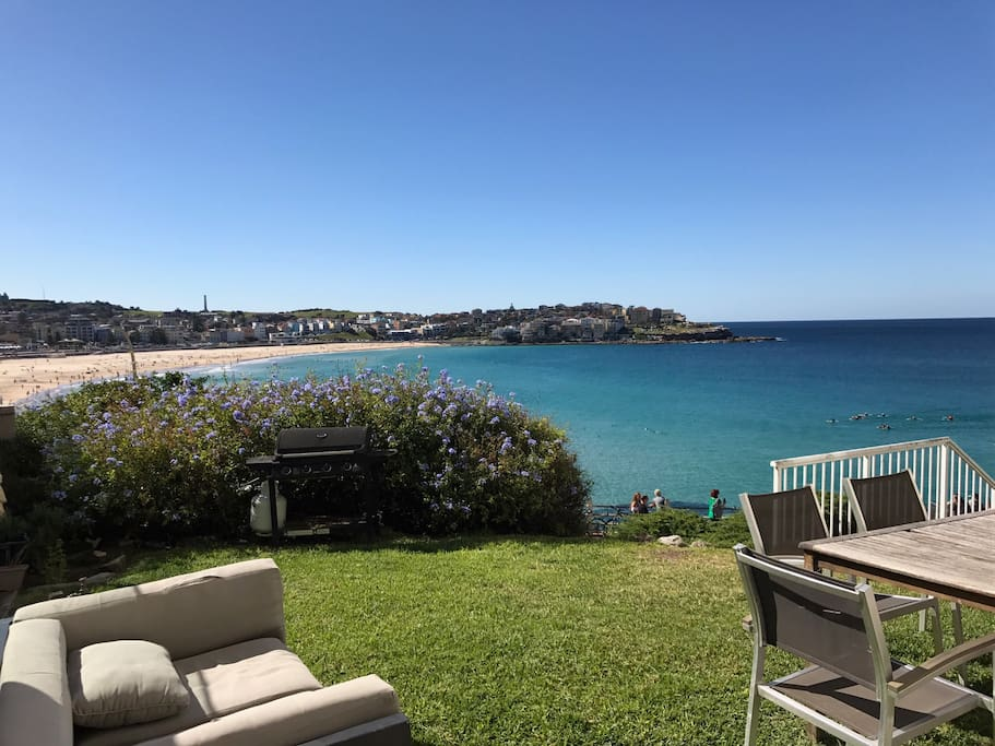 Garden overlooking Bondi Beach with BBQ, dining table and lounge (shared with neighbour)