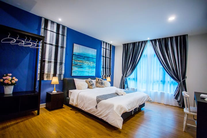 Deluxe Master Bedroom with King Bed and Laptop Space