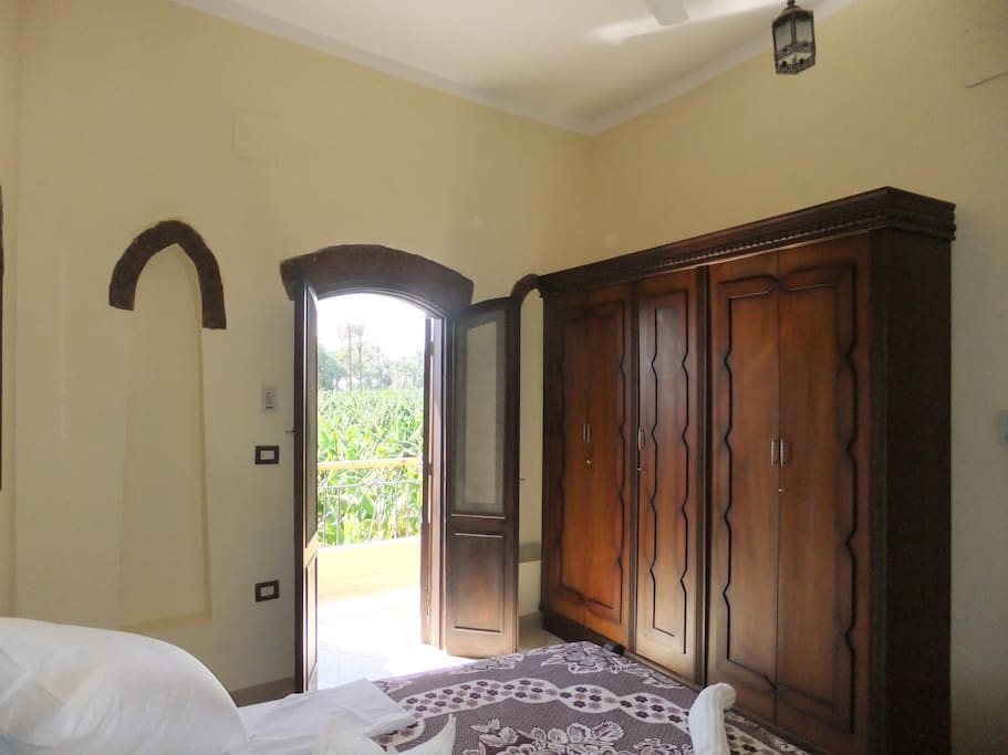 Double bedroom with private balcony overlooking banana plantation