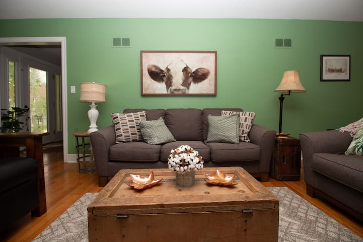 Cozy decor blending antiques with new furnishings
