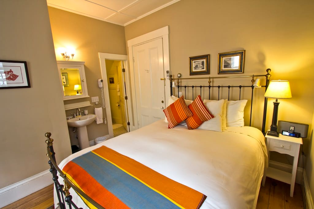 ► Room 1   Our rooms have been designed to maximize your comfort. We've chosen colors that are soothing and rich, which highlight the newly restored golden pine plank floors.