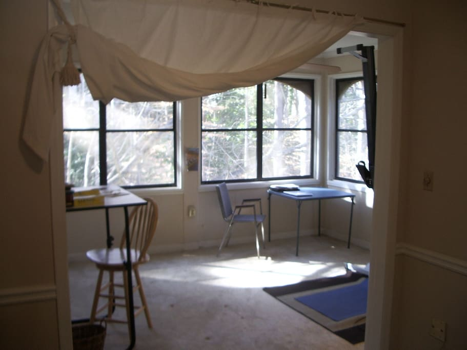 Sun porch can be used as office or bedroom