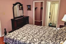 Beautiful second master bedroom ensuite with a queen size bed, desk, bathroom and walkin closet.