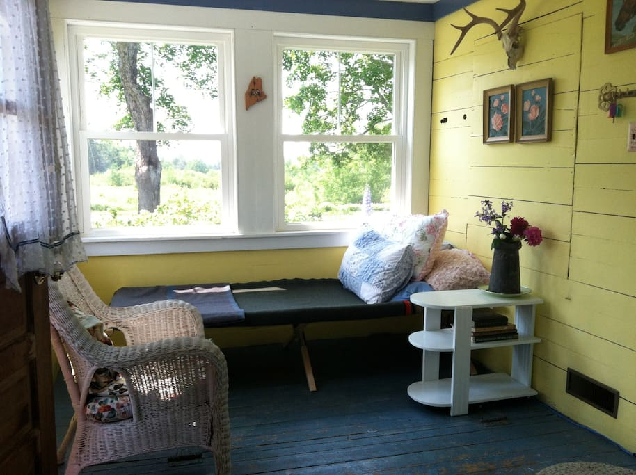 The sunroom (the old store) with summer cot