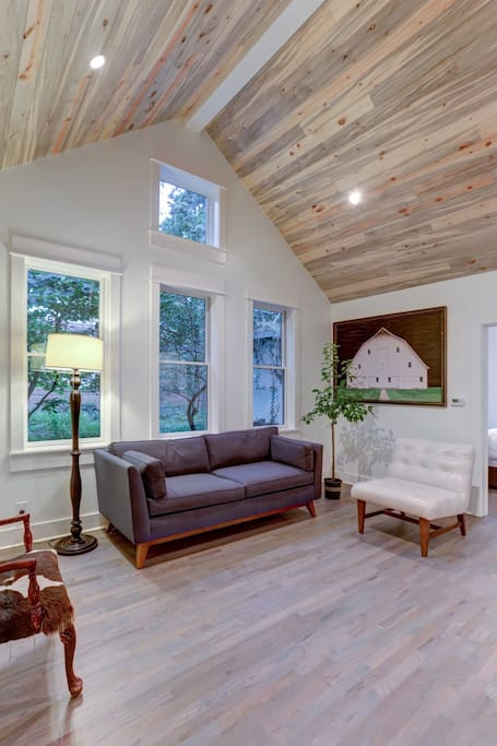 Cozy & bright living room with vaulted ceilings.
