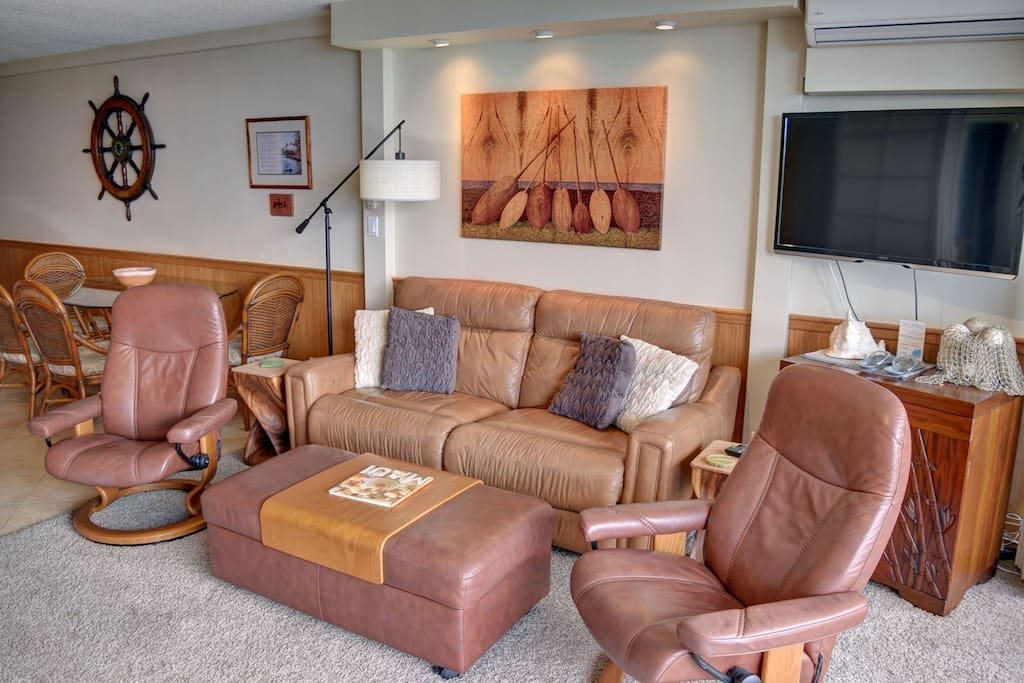 Living are with TV and comfortable furniture