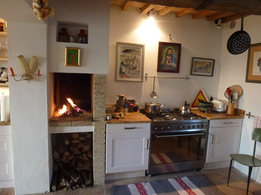 The kitchen has an open fire to cook on