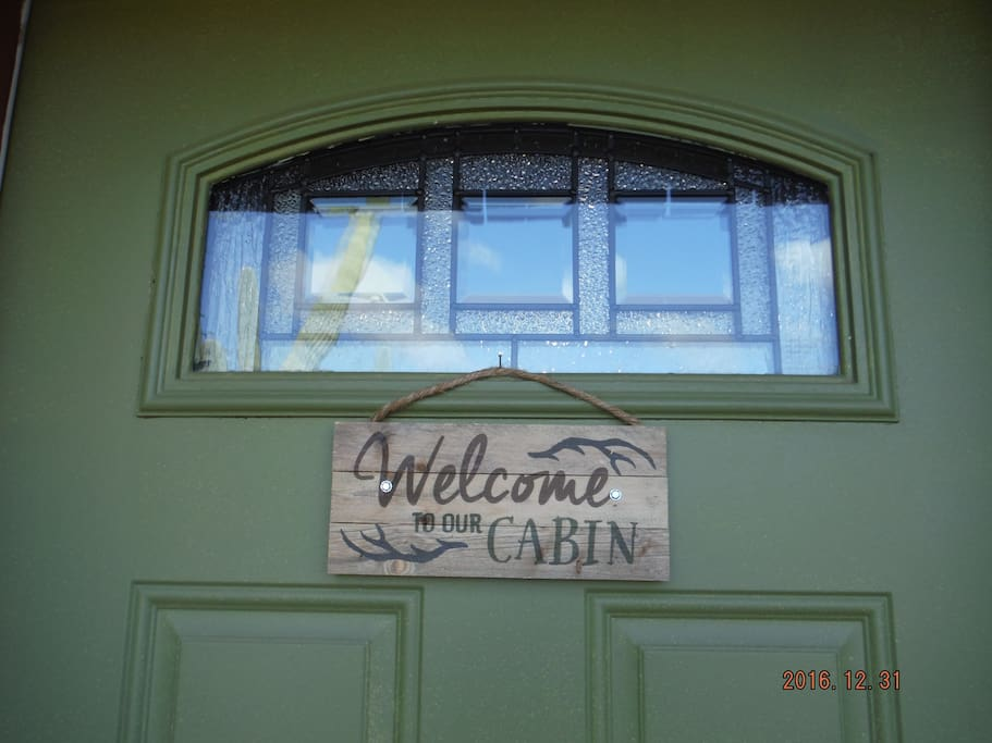 Look for the Welcome to our Cabin sign