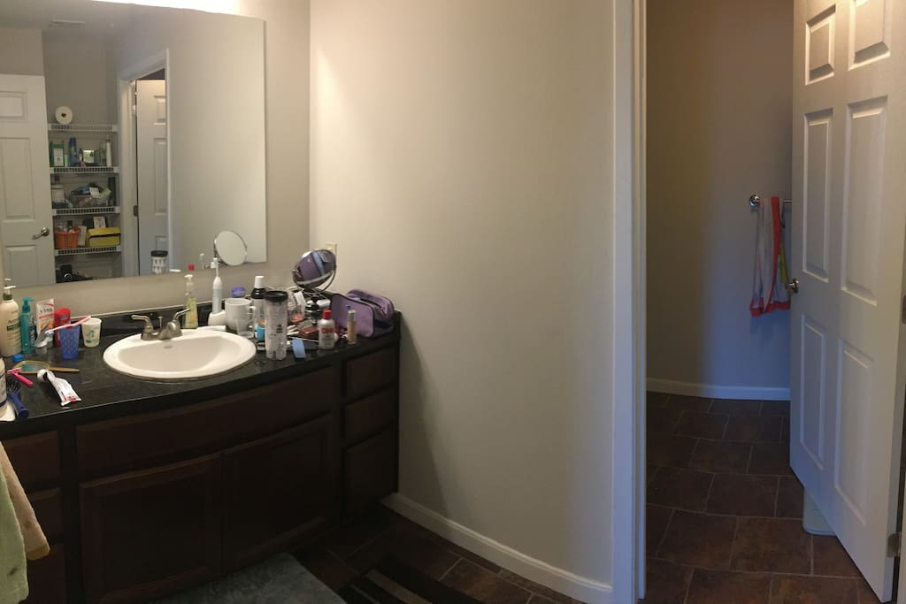 Huge bathroom, toilet/shower are separated from sink