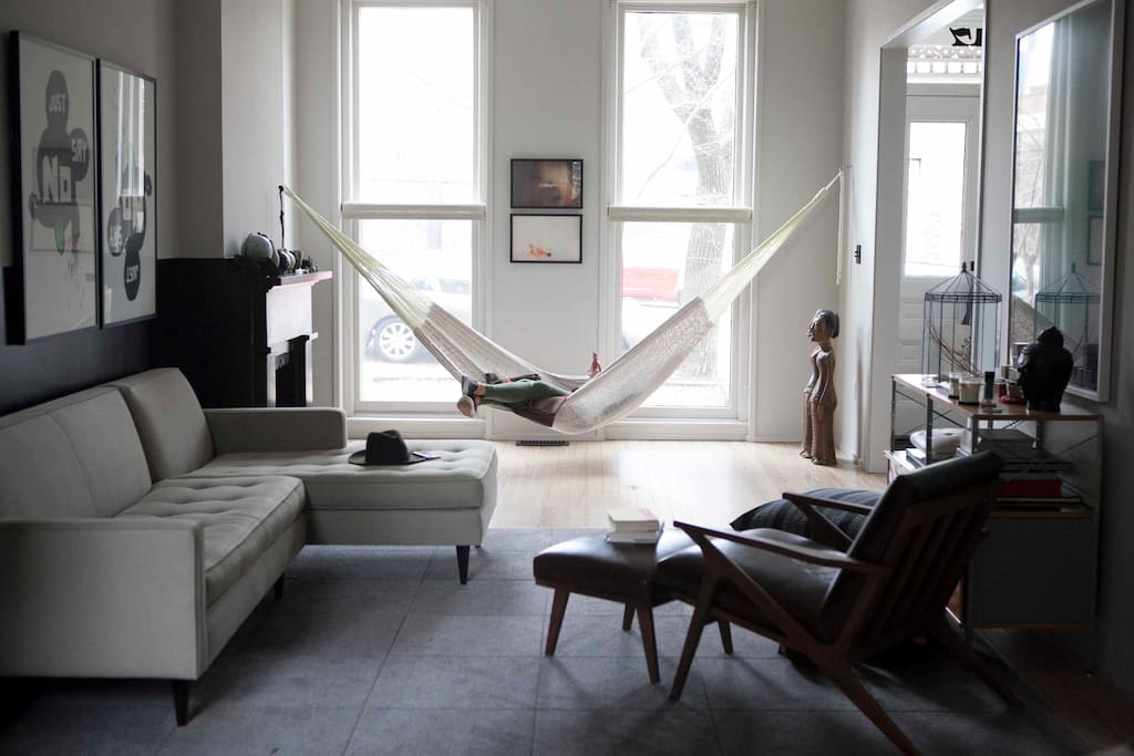 View of spacious Living Room from Kitchen. (Yes, that's a hammock.)