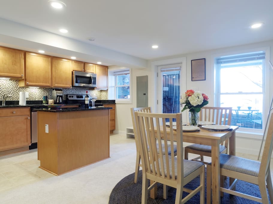 Inside is an open concept dining, kitchen and living space.