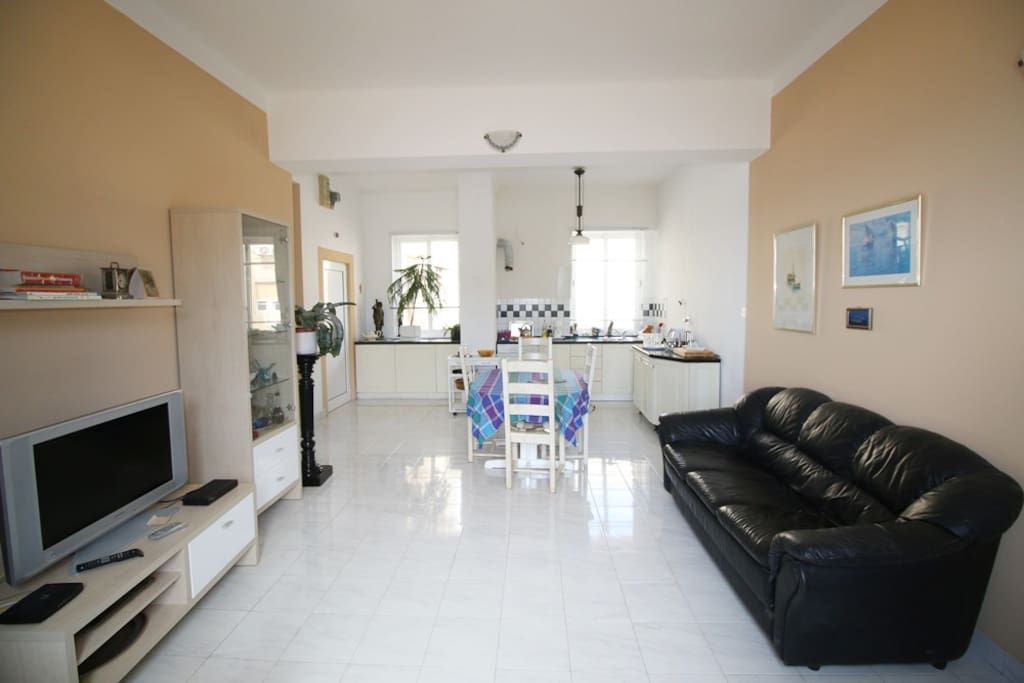 Living room, dining room and kitchen - all in one spacious room