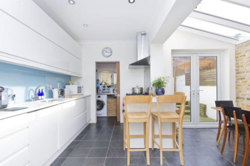 Bright and airy kitchen leading onto patio