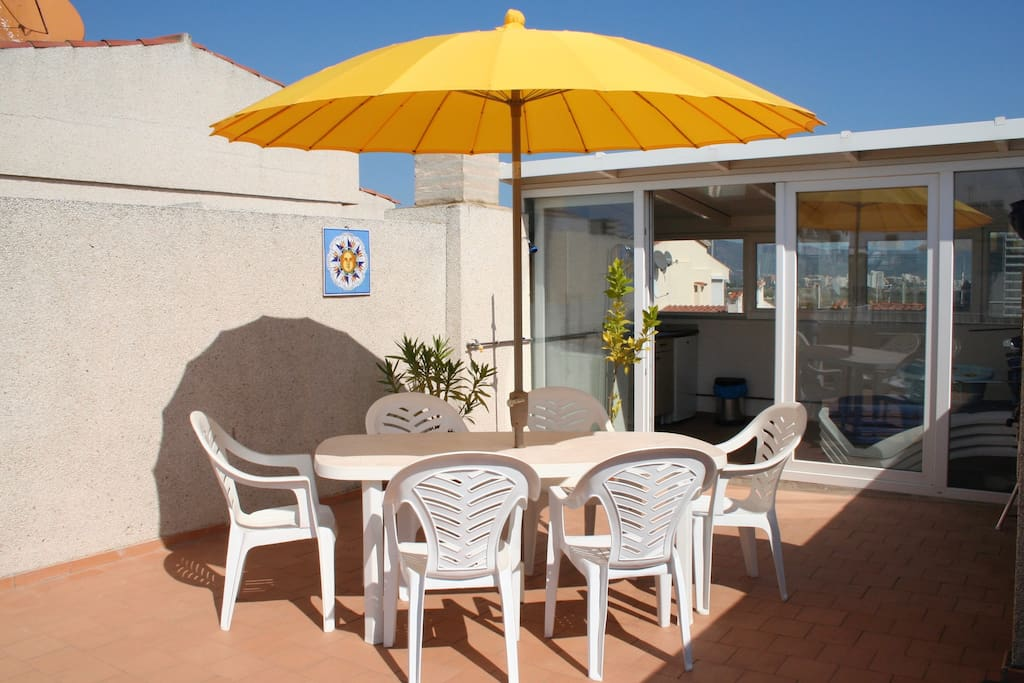 Sunny roof terrace with barbecue