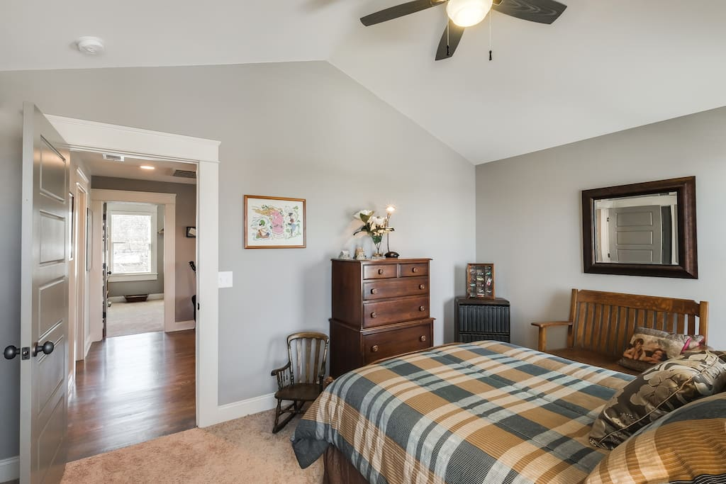 Guest rooms and bath are conveniently located off the loft seating area.