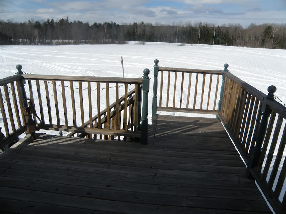 Deck overlooking the back field.
