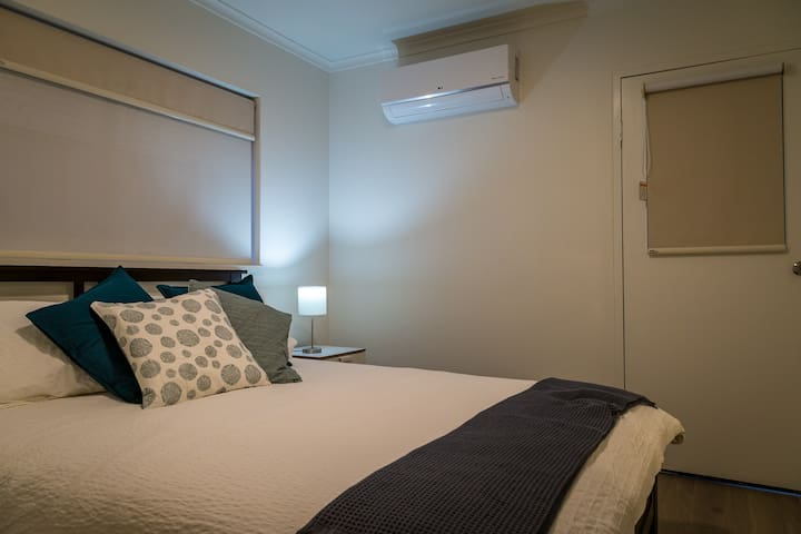 Bedroom 1 boasts a very comfortable queen size bed with hotel quality linen, a wardrobe that includes a lockable draw for your convenience and security and a 2.5kw heating/cooling unit to keep your room the perfect temperature all year round.