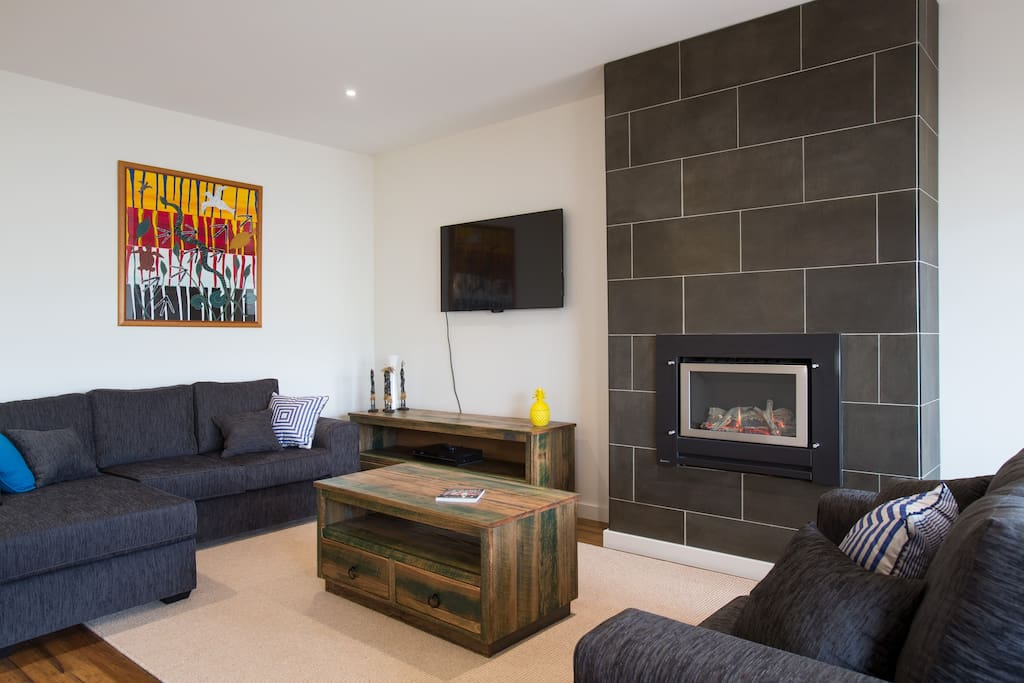 Spacious relaxed living with gas log fire adding warmth and comfort