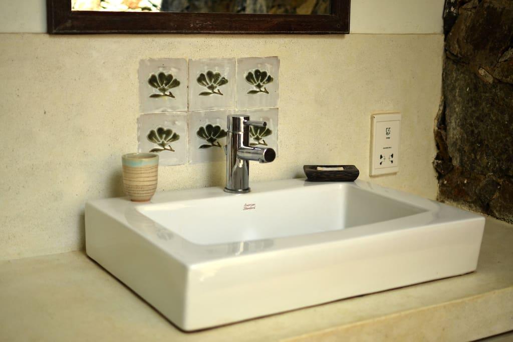 Basin in large inside/outside bathroom.
