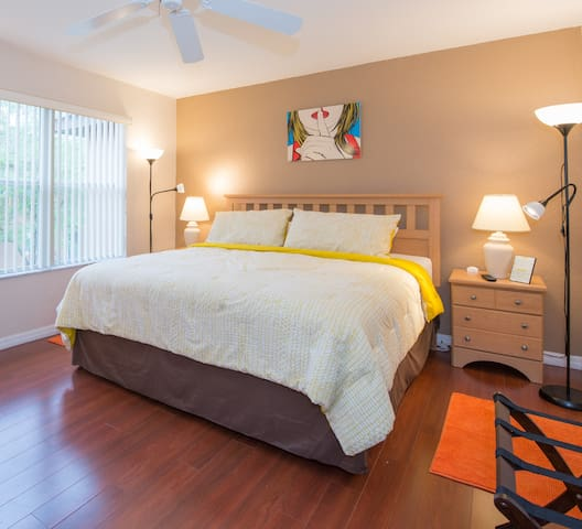 "[AIRBNB PHOTO] Master King Suite special bedroom with all the comfort, private bathroom, walk in closet, 32"" LED TV, ceiling fan and a place for your luggage"
