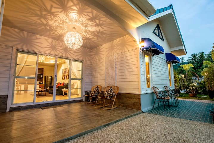 Large Covered Front Porch and Sun Patio.