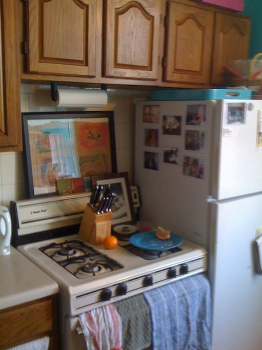 A huge, almost Midwestern-sized kitchen! Gas stove, fridge, every mod-con and the cutest shade of teal you've ever seen.  It even has a cuisinart.
