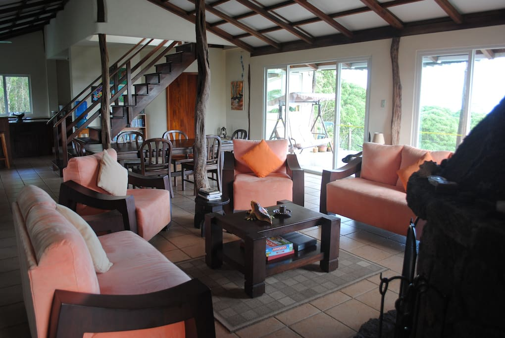 Lounge and dining area on the mid level of the lodge adjoins the main terrace with views south over forest to the ocean