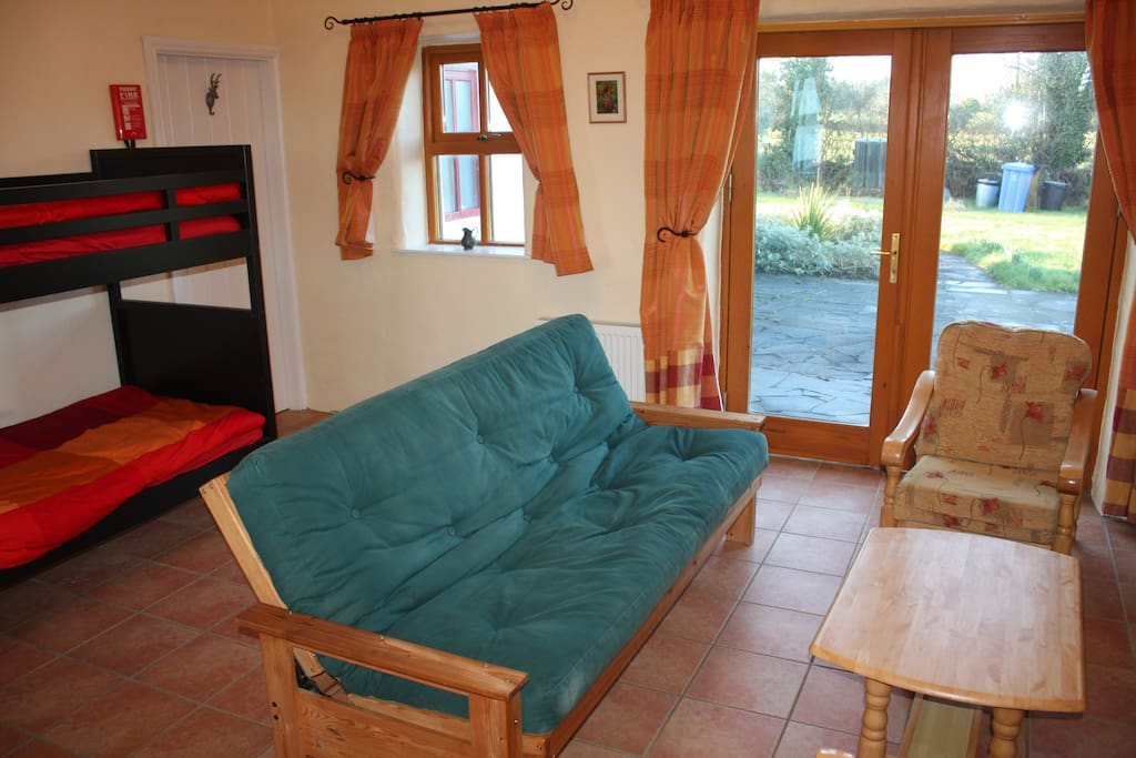 Studio bedroom with access to private patio, an ideal chill out zone with TV and we can provide wifi.