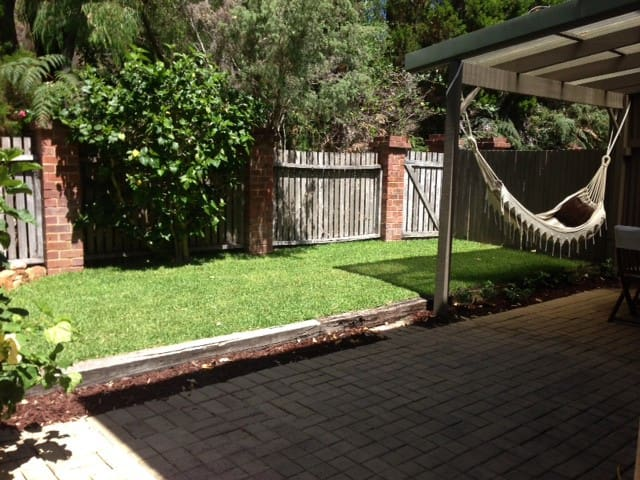 Grassed back yard with a covered slfresco area