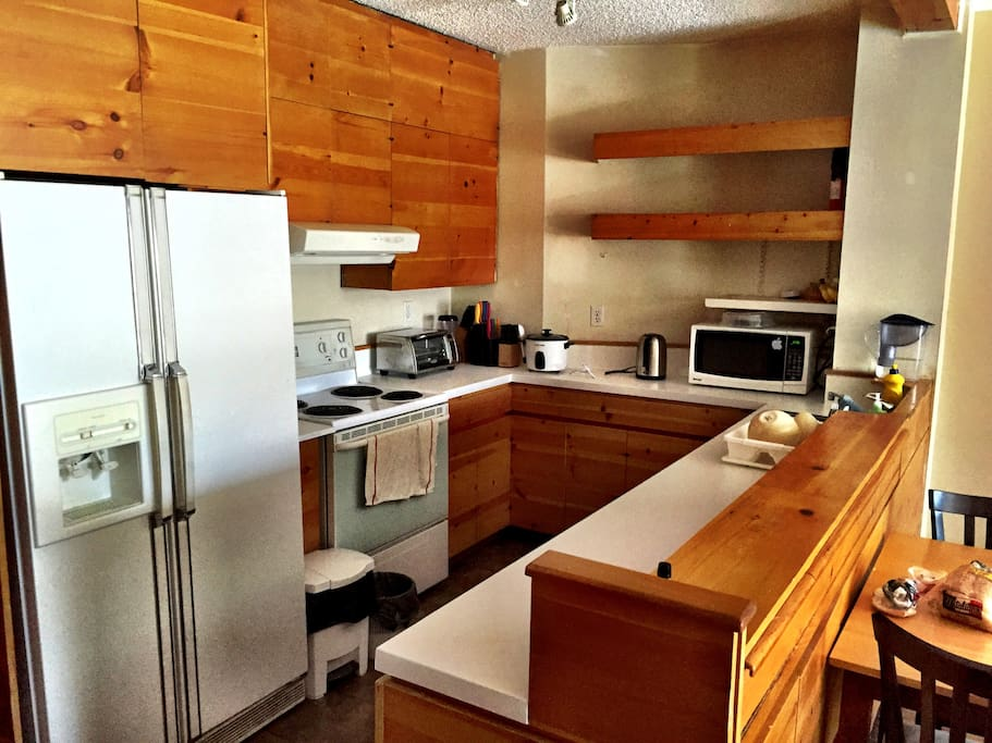 The kitchen!  Refrigerator, stove, oven, toaster oven, microwave.  Knives, cutlery, cookware all provided: cook away!