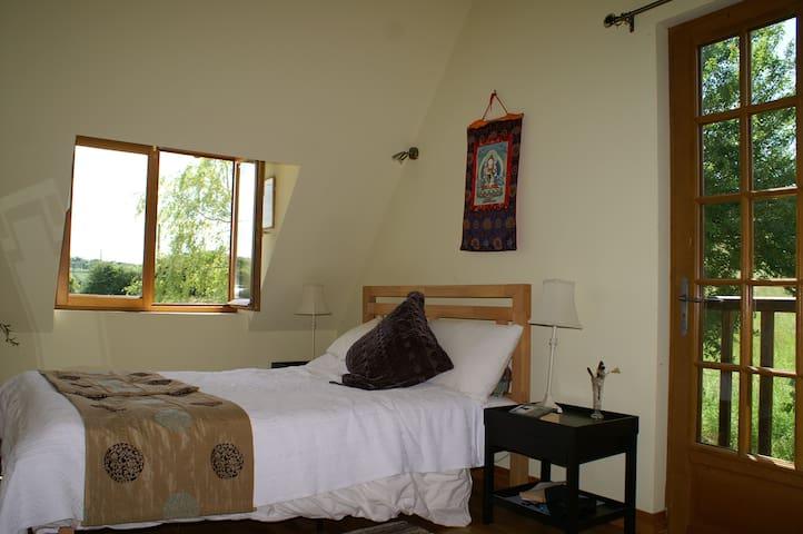 Master bedroom with view of garden.