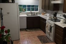 The kitchen comes ready with full access to the refrigerator, stove, dishwasher, coffee maker, and microwave.