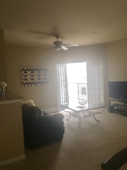 Living room with couch and access to balcony
