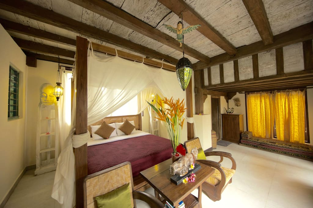 Your large Studio room with King sized bed. The window behind the bed looks straight out to the rice fields