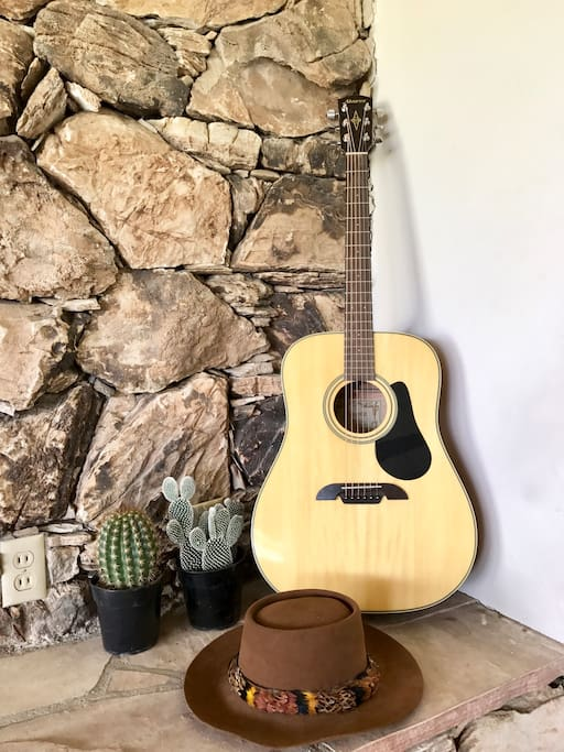 One of many guitars are found throughout the Coachella house.