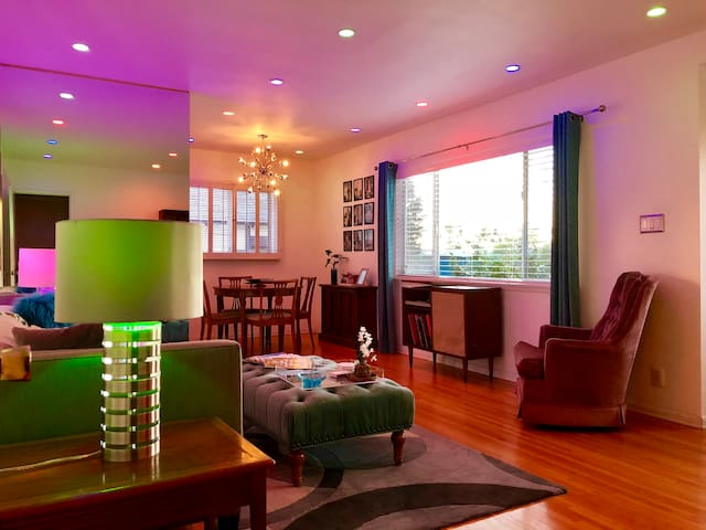 Living Room provides a Sputnik Chandelier along with Smart Red-Blue-Green, Dimmable, WiFi, LED Recessed Lighting