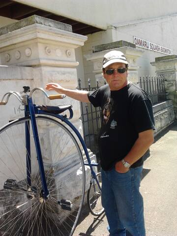 me standing by somebody else's penny farthing