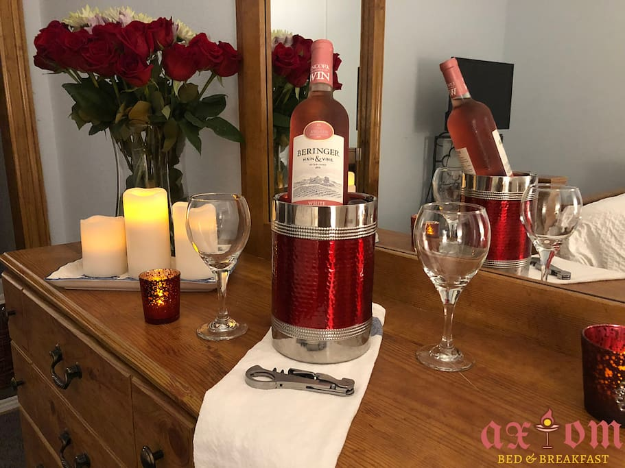 The romantic package includes fresh roses (or flowers of your choice), your choice of wine, flame-less candles, rose petals, sensual aromatherapy. All customized and personalized to fit your needs!