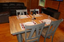 The dinning table is expandable to seat six guests.