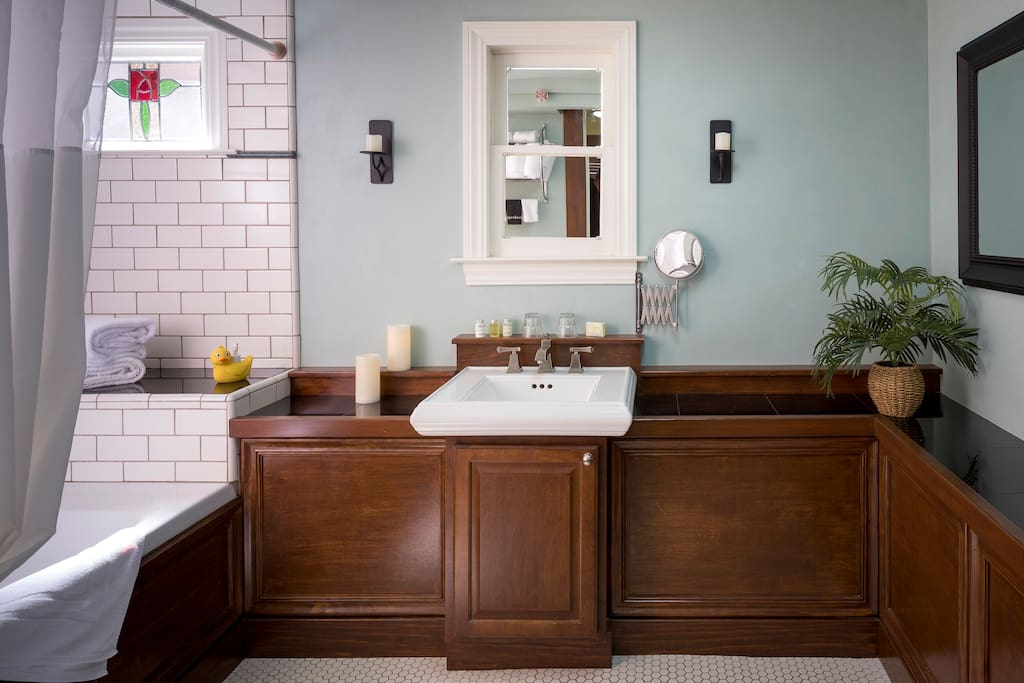 Luxe private bath has spa tub/shower combo, beautiful stained glass window, granite counters and tile shower with marble accents.