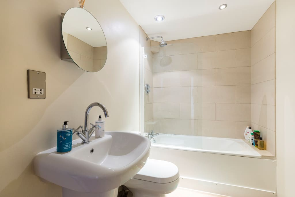 Clean and bright bathroom with amazing power shower and heated towel rail