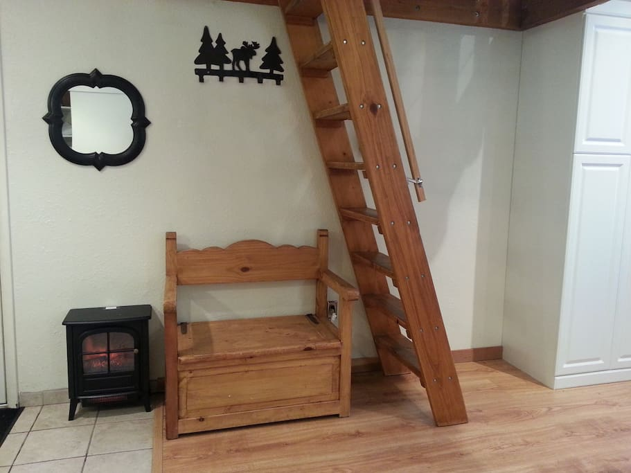Charming wood ladder for entry into the loft area of the condo.