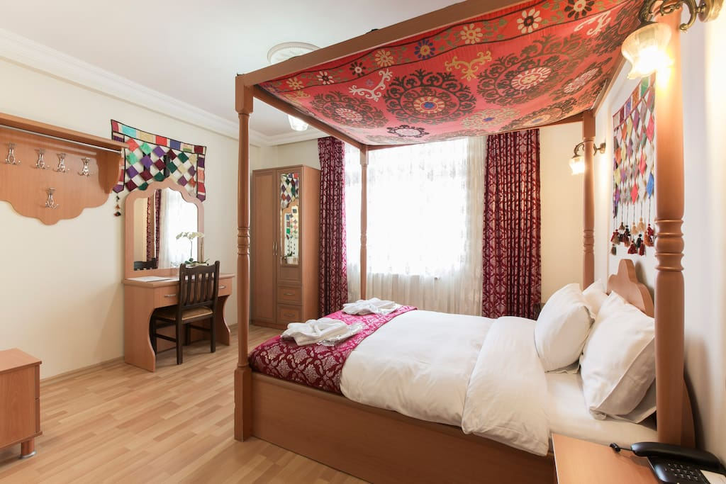 Double room with four poster bed.