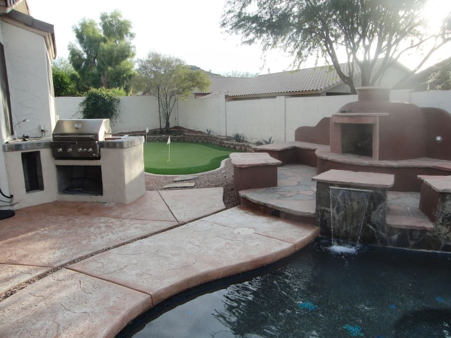 Putting green, fireplace and grill
