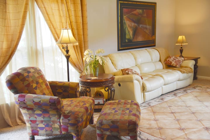 Living Room (private area): Expand beyond your guest room by enjoying the spacious living room. Includes leather sofa with two automatic recliners.