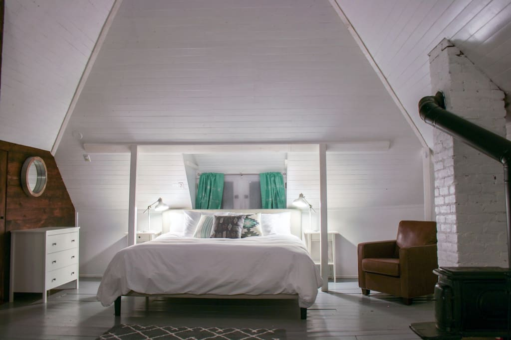 House #1, Bedroom #2 - King size memory foam bed in renovated attic with wood burning stove.