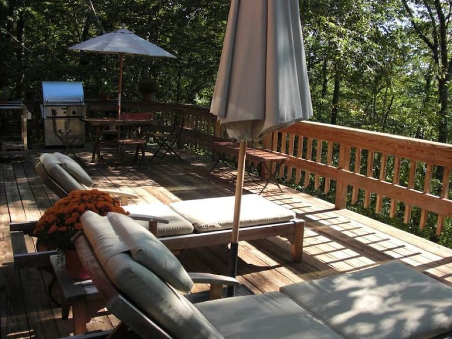 deck with grill and tables