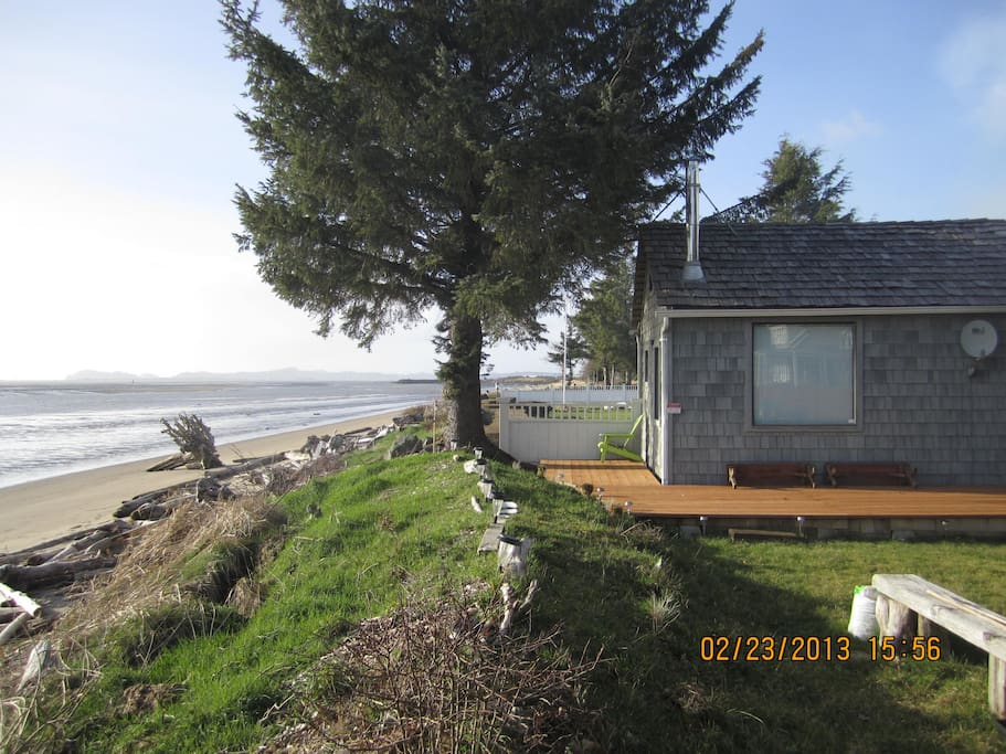 Original 2013 photo of self-contained 600 sqft studio with cedar interior, surrounding area and main house at background...